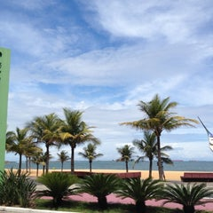 Photo taken at Praia da Costa by Grazielly F. on 11/10/2012