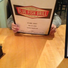 Photo taken at Blue Fish Grill by Robyn F. on 3/7/2013