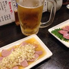 Photo taken at もつやき処 い志井 本店 by Kinosita M. on 6/27/2015