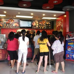 Photo taken at KFC by Francis T. on 7/24/2014