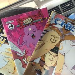 Photo taken at Ash Avenue Comics and Books by Alaina E. on 9/9/2014