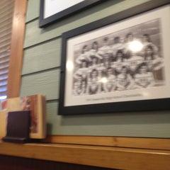 Photo taken at Ninety Nine Restaurant by Elena H. on 5/3/2013