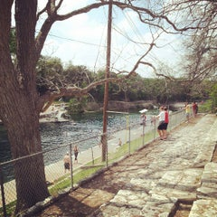 Photo taken at Barton Springs Pedestrian Bridge by Crisy B. on 4/1/2013