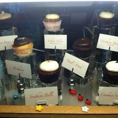 Photo taken at Red Velvet Cupcakery by Erin B. on 10/12/2012
