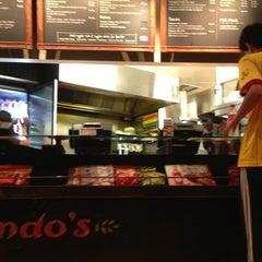 Photo taken at Nando's by Alex R. on 2/17/2013