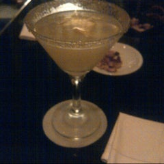 Photo taken at The Library Bar & Cigar Lounge at Four Seasons Hotel Doha by Nora M. on 5/20/2013