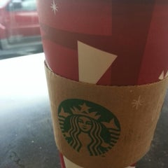 Photo taken at Starbucks by Khozeima F. on 12/24/2012
