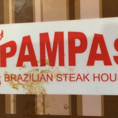 Photo taken at Pampas Brazilian Steak House by Jeff H. on 1/1/2014