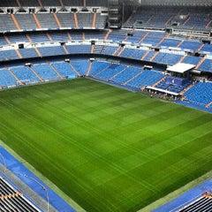 Photo taken at Estadio Santiago Bernabéu by Dani B. on 7/28/2013