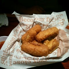 Photo taken at Red Robin Gourmet Burgers by Pete R. on 10/4/2012