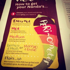 Photo taken at Nando's by Stacey Y. on 2/1/2013
