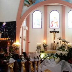Photo taken at Gereja Katolik Kristus Raja by Yenny H. on 12/24/2013