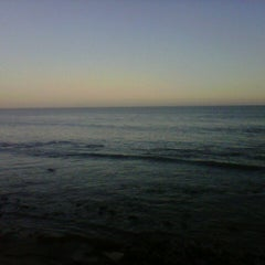 Photo taken at Malibu Public Beach by Cristina M. on 9/2/2012