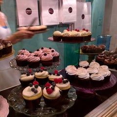 Photo taken at Lavender Moon Cupcakery by Jenn Z. on 7/4/2015