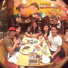 Photo taken at Xin Wang Hong Kong Café 新旺香港茶餐厅 by Hanee A. on 3/1/2014
