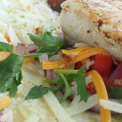 Photo taken at Windansea Restaurant and Tiki Bar by Lauren C. on 8/4/2014