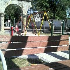 Photo taken at Jardín de San Miguel de Mezquitán by Galileo O. on 1/26/2013