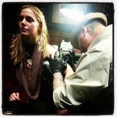 Photo taken at Zebra Tattoo & Body Piercing by Jesse B. on 12/27/2012