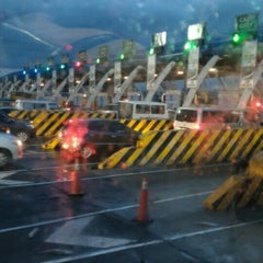 Photo taken at NLEx Bocaue Toll Plaza by Robertson F. on 8/9/2015