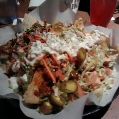 Photo taken at Buffalo Wild Wings Grill & Bar by Chris C. on 3/9/2013