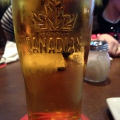 Photo taken at Boston Pizza by Rebecca C. on 7/7/2014
