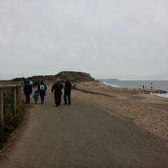 Photo taken at Hengistbury Head by Bex L. on 12/26/2014