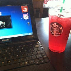 Photo taken at Starbucks by Erica S. on 6/30/2013
