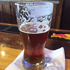Photo taken at The Library Sports Grill and Brewery by David E. on 1/23/2015
