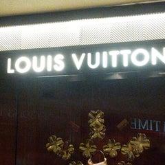 Photo taken at Louis Vuitton by J V. on 11/19/2012