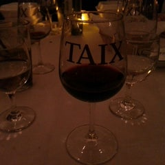 Photo taken at TAIX French Restaurant by Karen W. on 2/10/2013