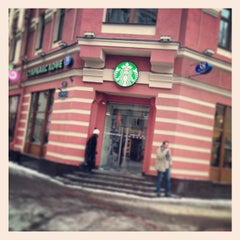 Photo taken at Starbucks by Oleg S. on 1/10/2013