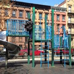 Photo taken at Marcus Garvey Park by Nichi B. on 4/21/2013