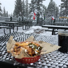 Photo taken at Summit Deck & Grill at Northstar California™ Resort by Trevor S. on 12/19/2015
