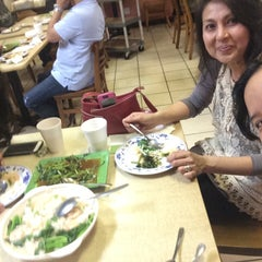 Photo taken at Lion City Chinese Cafe by Liz G. on 4/11/2015