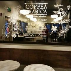 Photo taken at Starbucks by Phoebe H. on 12/4/2015