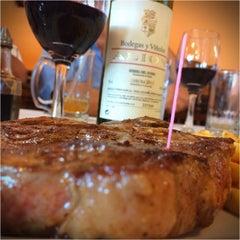 Photo taken at La Siesta Restaurant Bar by Hector O. on 10/7/2014