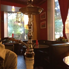 Photo taken at Anatolia Cafe & Hookah Lounge by E. H. on 5/5/2013