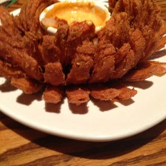 Photo taken at Outback Steakhouse by Eric W. on 12/29/2012