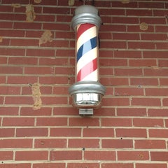 Photo taken at Chuck Simon's Barber Shop by Michael M. on 2/23/2013