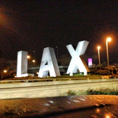 Photo taken at LAX Sign by Lami H. on 4/8/2013