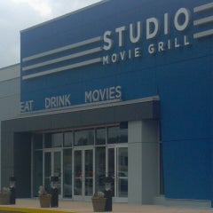 Photo taken at Studio Movie Grill by Christian B. on 3/31/2013