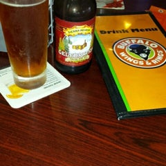 Photo taken at Buffalo Wings & Rings by Titus C. on 12/13/2014