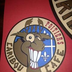 Photo taken at Le Caribou Cafe by Gaëtan R. on 12/12/2012