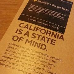 Photo taken at California Pizza Kitchen by Tisha R. on 3/4/2013