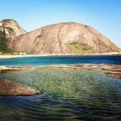 Photo taken at Praia de Itacoatiara by Luan P. on 1/1/2013