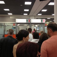 Photo taken at Паспортный контроль / Passport Control (E) by Владимир Б. on 10/3/2012