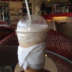 Photo taken at Coffee Me by Sujitporn Coffee & Bakery House by Nooch G. on 8/12/2014