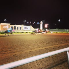 Photo taken at Bar & Book at Lone Star Park by Emily S. on 10/5/2014