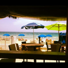 Photo taken at Bamboo Beach Tiki Bar & Cafe by Joanna V. on 6/23/2013