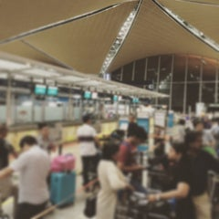 Photo taken at Gate A8 by Kim 赤. on 6/11/2015